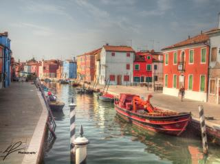 The pastel colours of the low rise buildings decorating the canals of Burano make for a beautiful backdrop.
