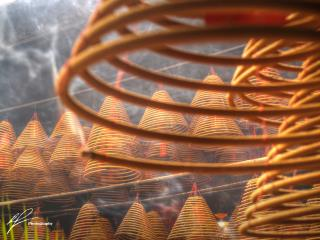 From the Northern Territories near Hong Kong, this shot was taken inside a Chinese temple, illustrating the serene nature of the many coils of incense slowly burning away.