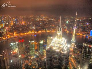 From the Jin Mao tower in the Pudong district in downtown Shanghai, we get a brilliant view of the city lights by night.