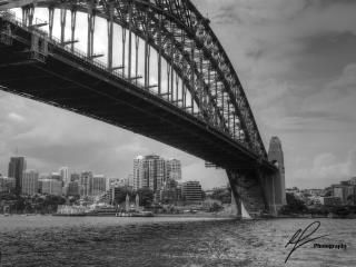 Just near Dawes Point Park, there is a nice view of North Sydney and Luna Park from underneath the massive shadow of the Harbour Bridge.