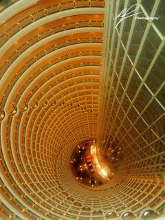 The amazing view inside the famous Jin Mao tower in the Pudong district in Shaghai, China.  The view encompasses a view of a drop of about 30 stories.